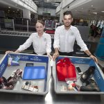 Airport Security Screening Officers, Michelle Halpin and Sergio Rocha with a sample of what passengers should place in the trays at security screening. Photo: Dublin Airport